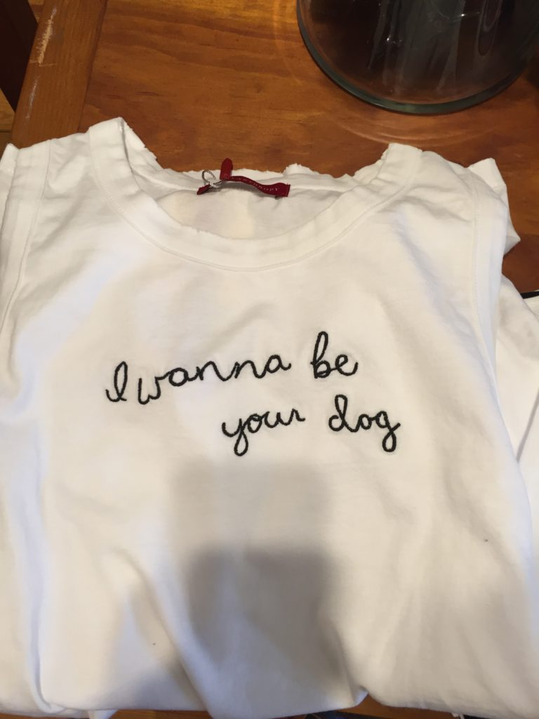 """This quirky sleeveless tee has the words """"I wanna be your clog"""" embroidered on the front to add an extra element and a more complex detailing. This funny little tee is from If the Shoe Fits in Orleans."""
