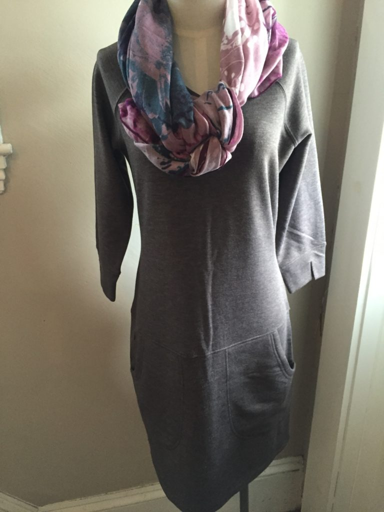 This grey sweatshirt shirt dress is a perfect casual look for a day out on the town and can be found at Beth Bishop in Orleans.